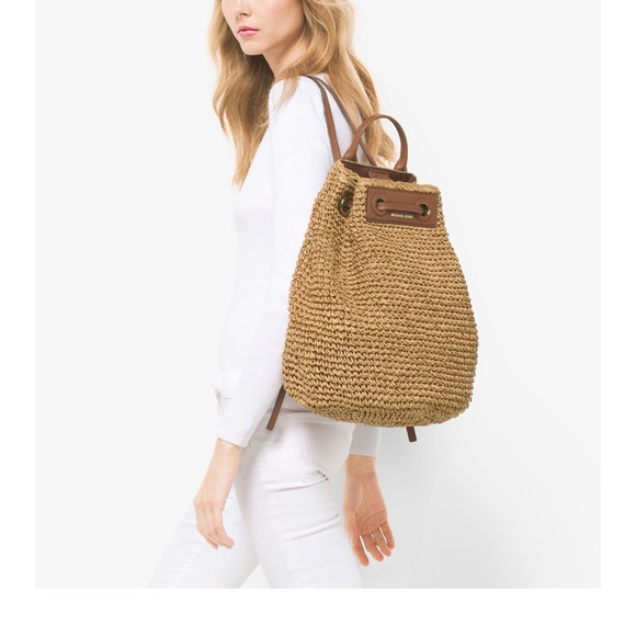 6d2bf8a00c91 Michael Kors Krissy Straw Natural Backpack. M_5a87a98cf9e501c463c1044c